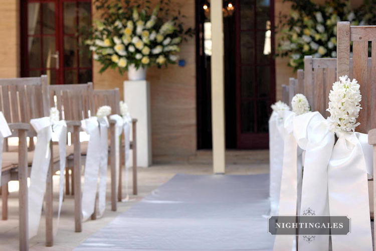 Genoris blog crisp white table linens and wooden folding chairs church wedding junglespirit Images